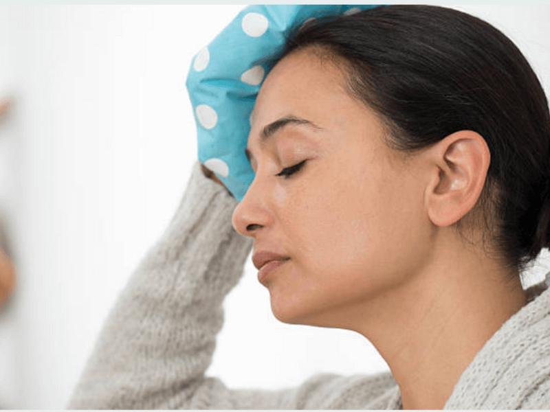 Woman holding ice pack
